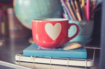 Valentine's coffee mug on a desk