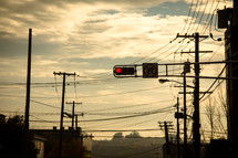 red stop light and power lines