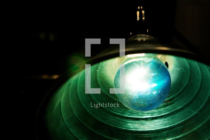 Blue lightbulb in light fixture