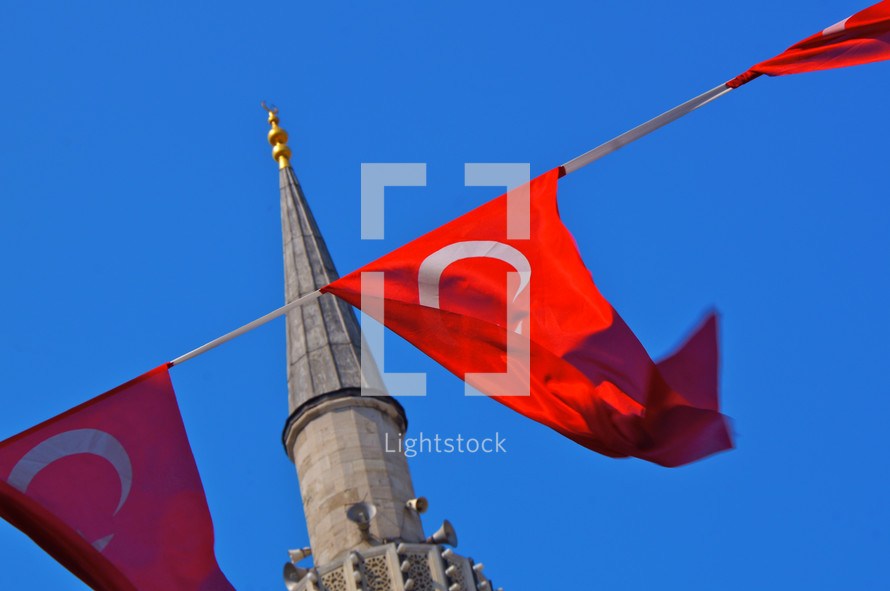Turkish flags hanging near a mosque