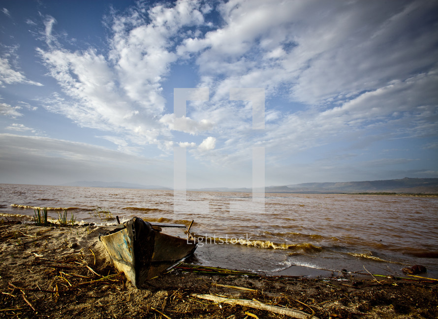 A washed up fishing boat on the shore