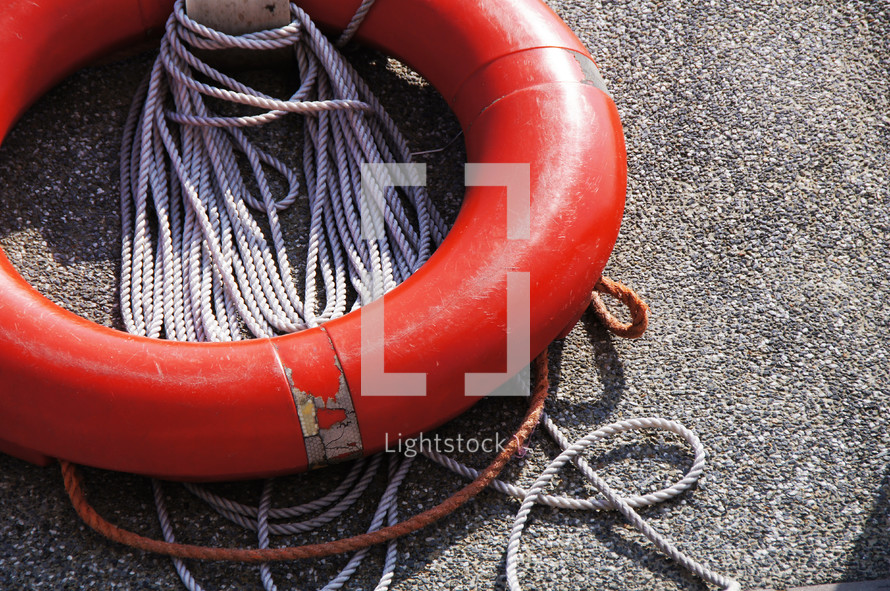 Life preserver, lifesaver or lifebuoy and securing rope