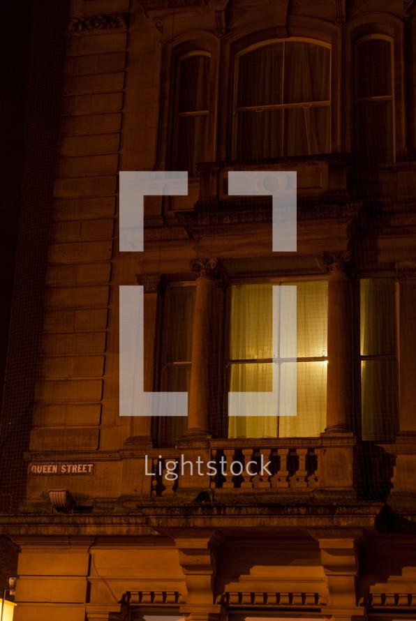 light on in a townhouse window
