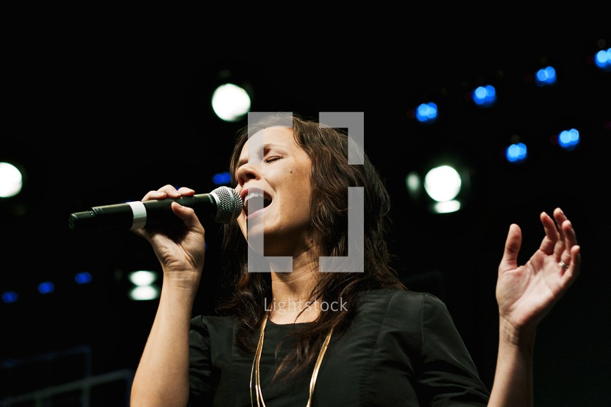 woman singing at a concert