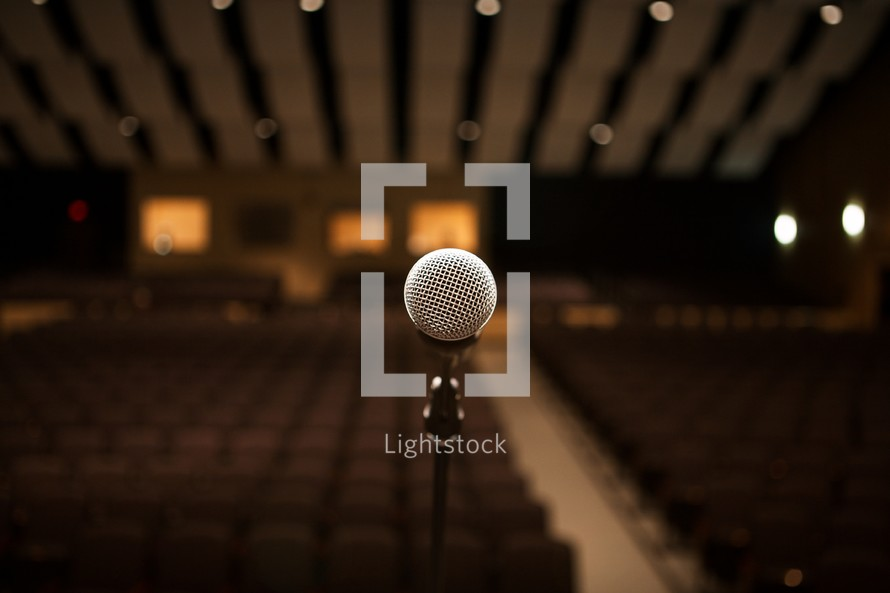 Microphone on stage in an empty auditorium
