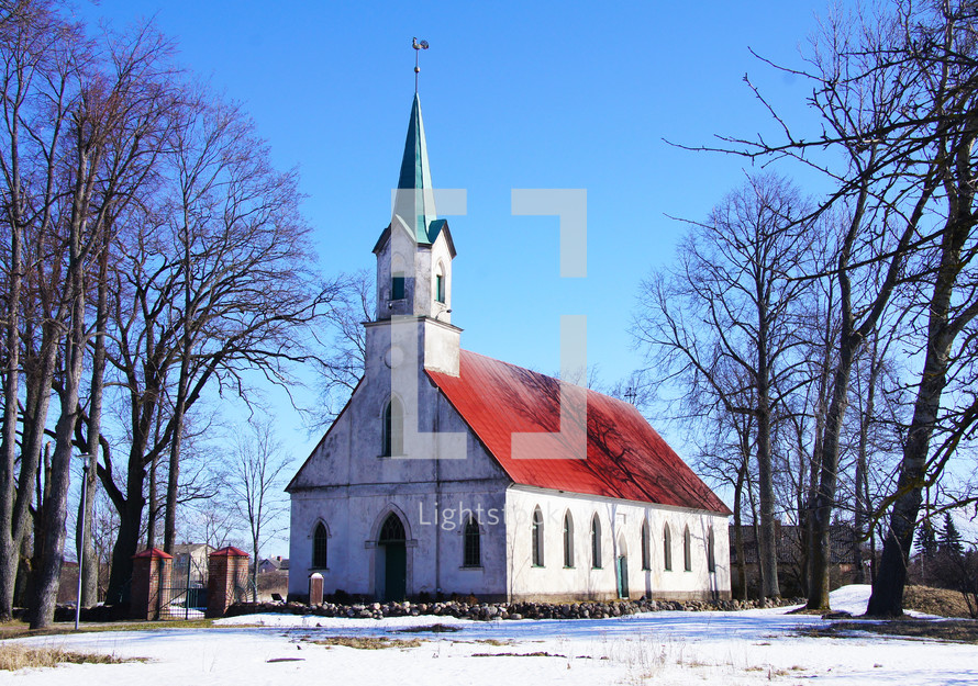 A charming old church building in winter surrounded by snow