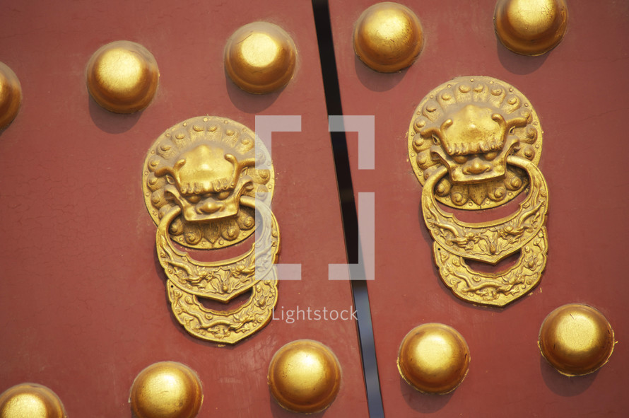 Forbidden Palace main gate doors with dragon handles and brass studs