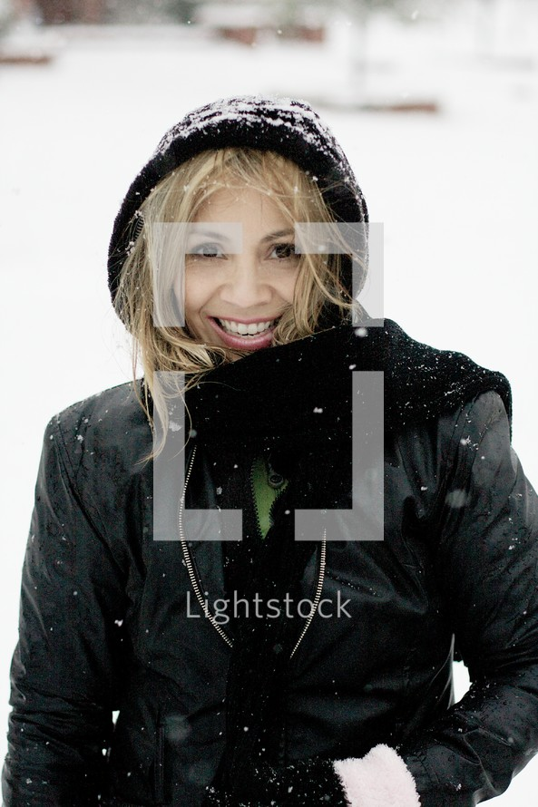 A woman smiling in the snow