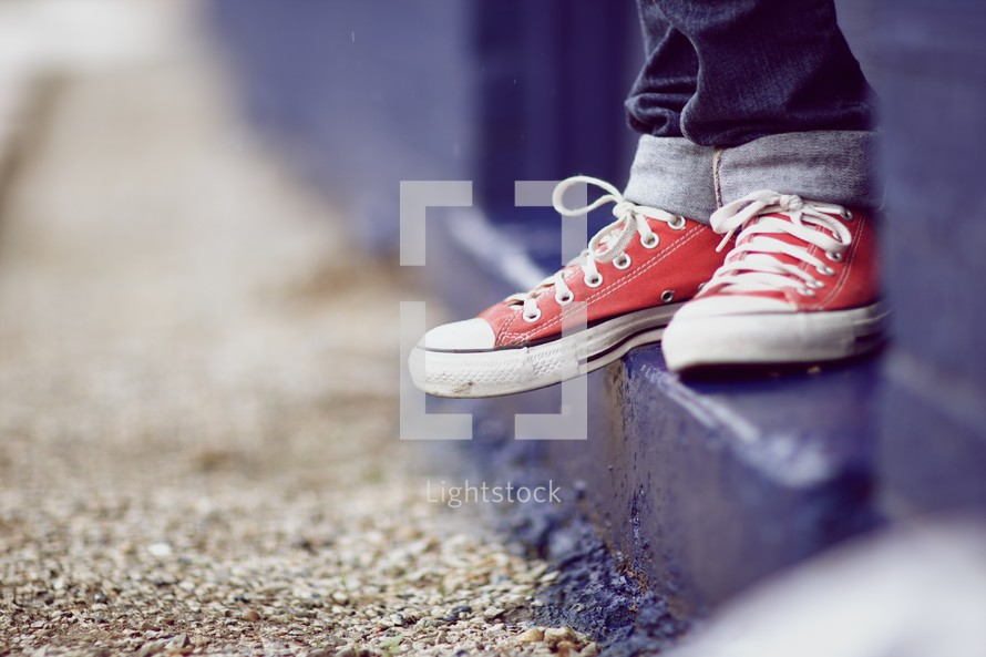Close up of kids shoes standing on a step