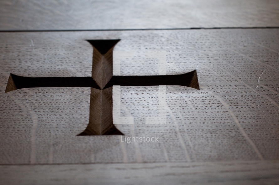 Cross carved in to wood.