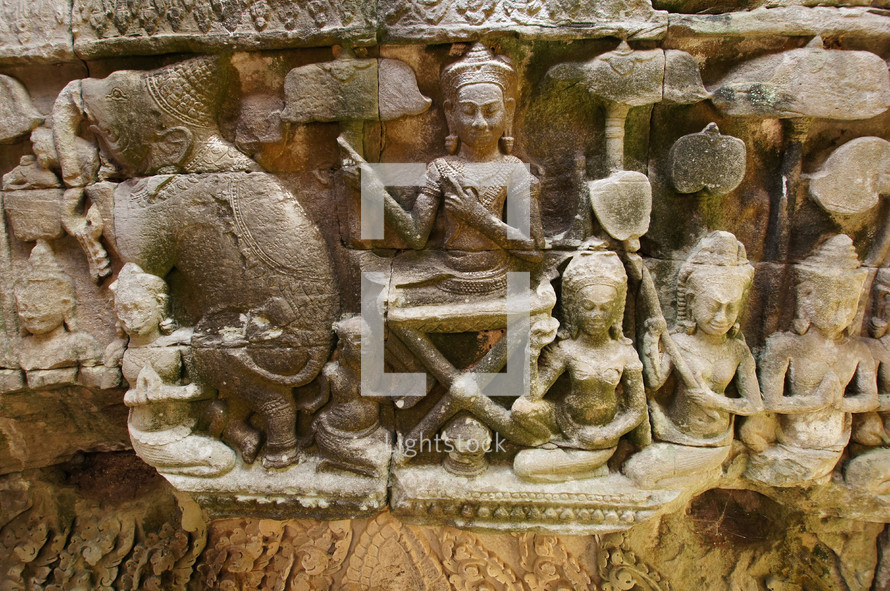 Carved stone wall relief depicting Hindu Gods
