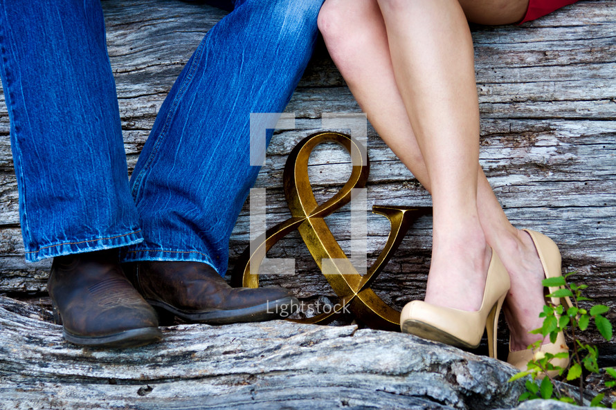 a couples legs and feet and an & sign