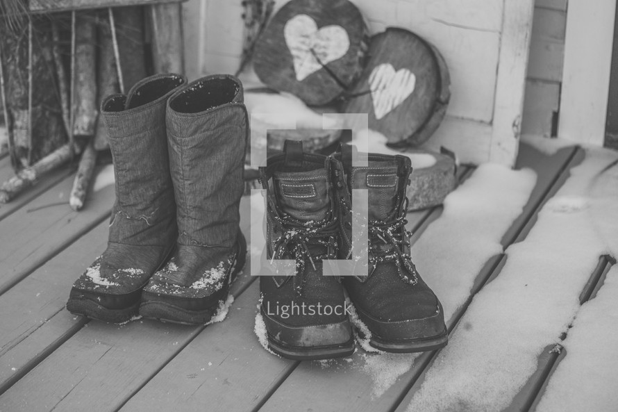 boots on a snowy porch in winter