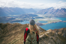 a woman standing on a mountaintop backpacking through New Zealand