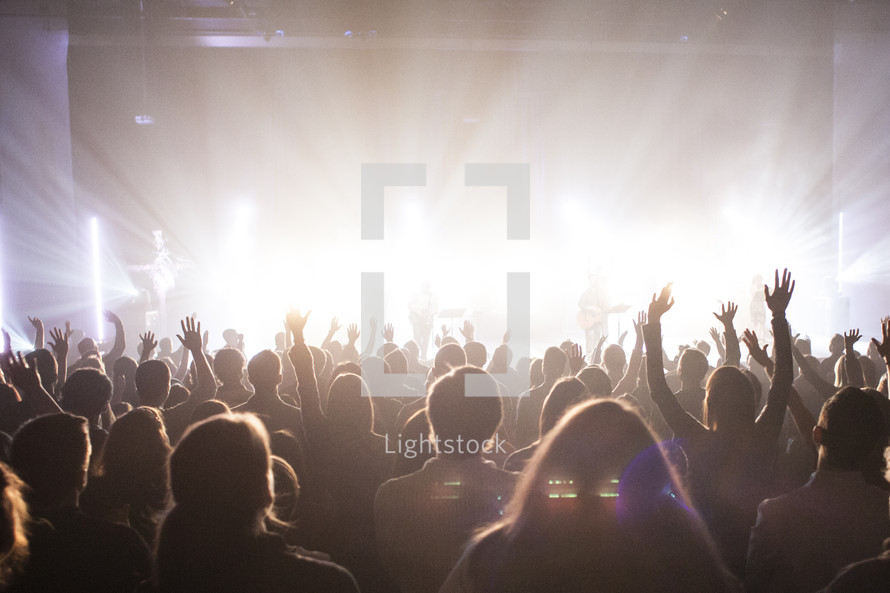 A contemporary praise and worship service - hands lifted in worship