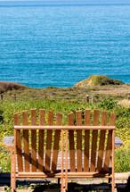 adirondack bench overlooking the ocean