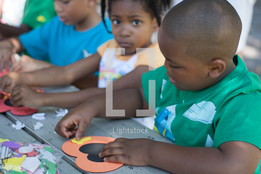 Children doing crafts on a mission trip.