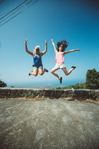 women leaping into the air