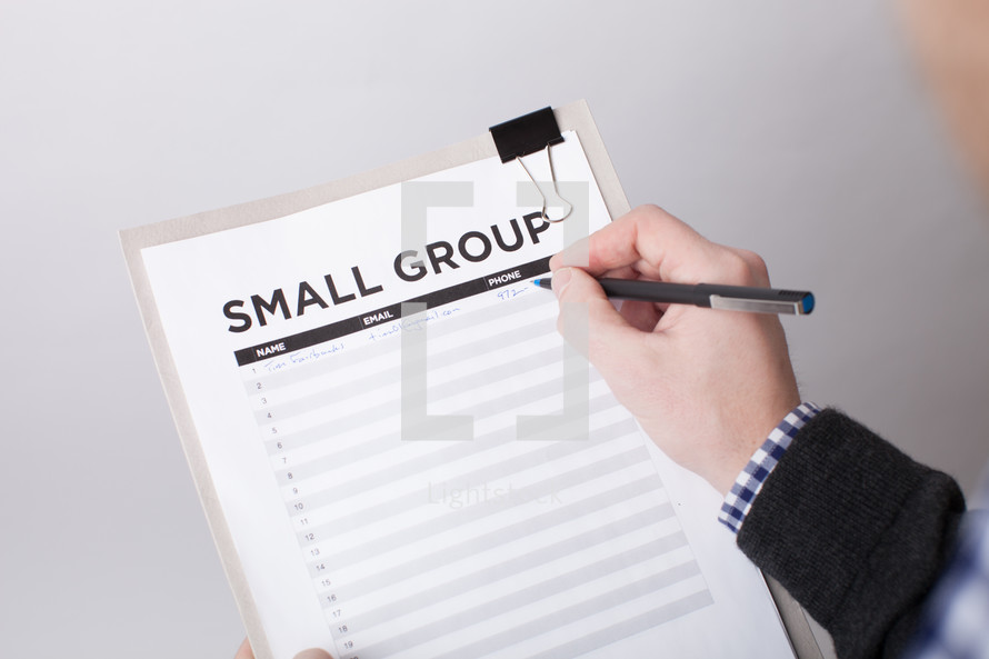 A man signing up to be in a small group