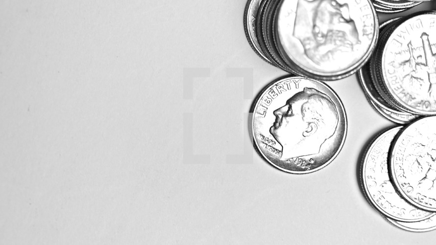 Stacks of dimes isolated on white