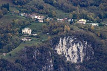 homes on a green slope on a mountainside