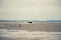 boats on a dry lake beached on the sand