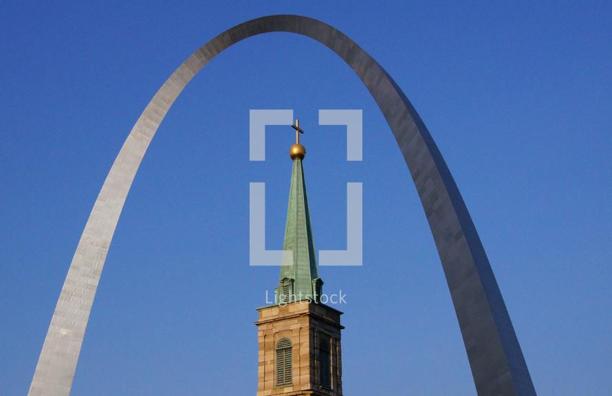 church steeple and Gateway Arch