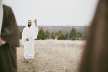 Jesus waving goodbye to disciples.