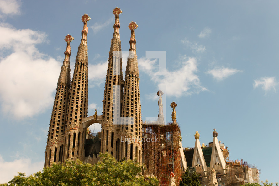 The Basílica i Temple Expiatori de la Sagrada Família, commonly known as the Sagrada Família, is a large Roman Catholic church in Barcelona, Spain, designed by Catalan architect Antoni Gaudí.