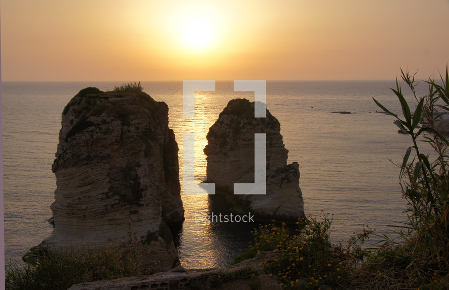 Overlooking two ocean rock formations at sunrise