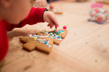 a child decorating Christmas cookies