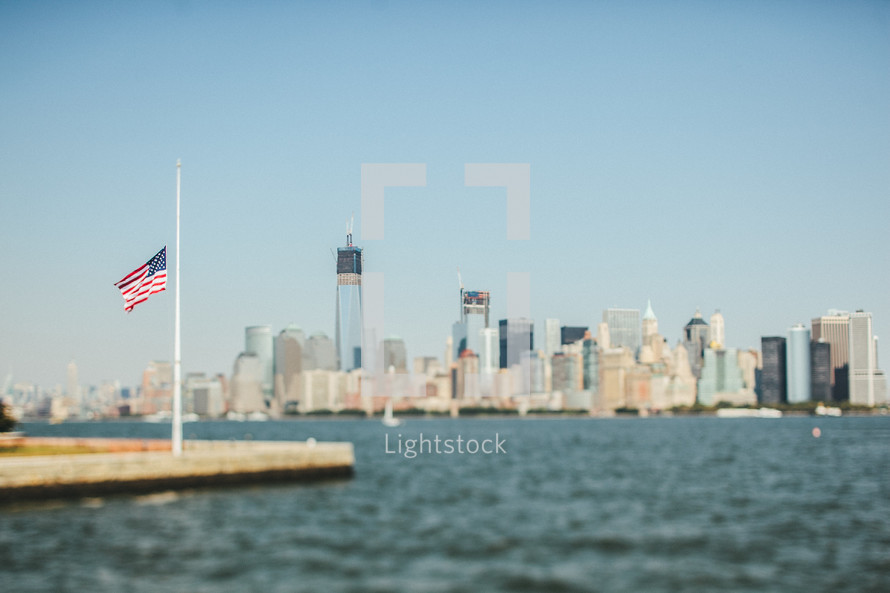 an American flag on a harbor on New York City