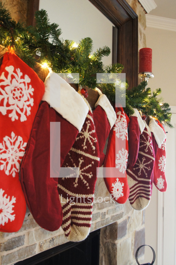 Christmas stockings hung on a mantle