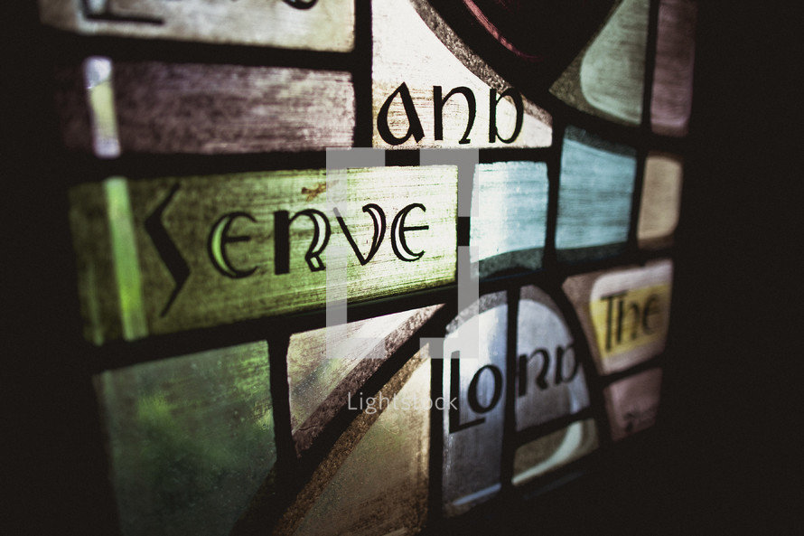 Stained window glass - go and serve the Lord