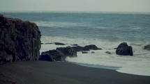 waves crashing into rocks along a shore