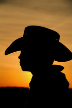 Silhouette of boy in cowboy hat