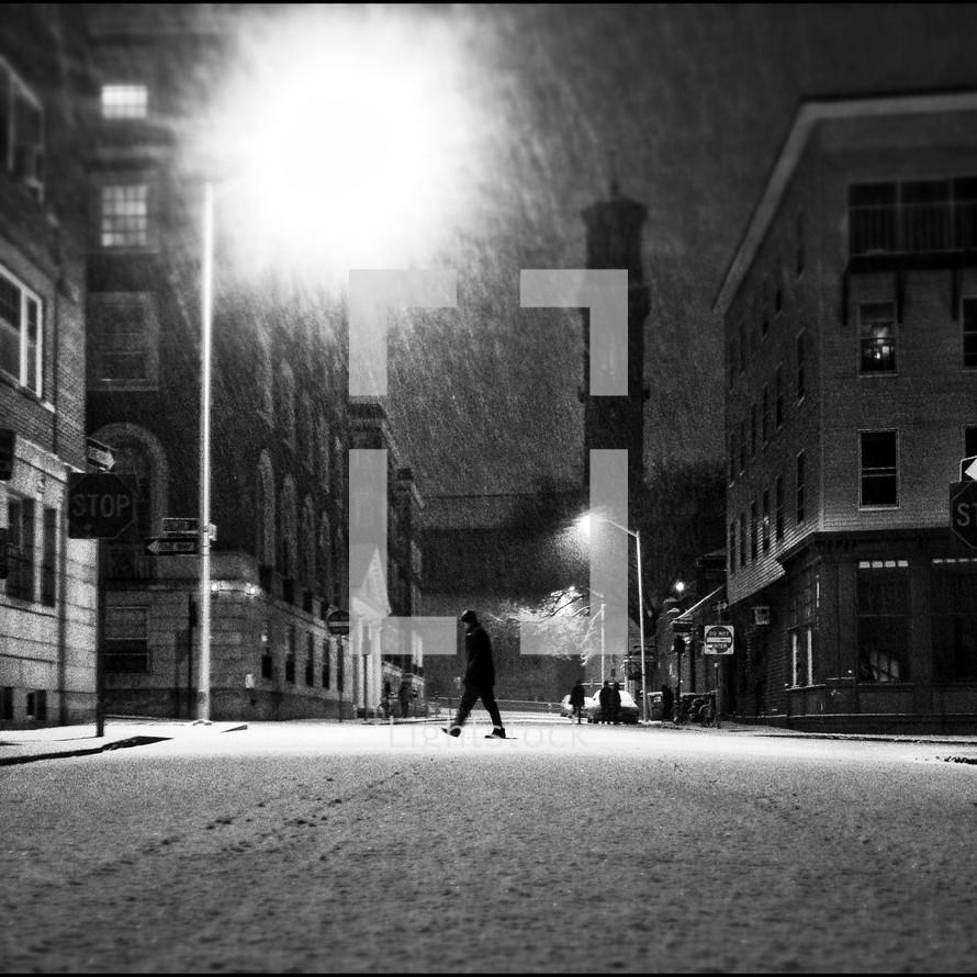 Man walking across street in snow