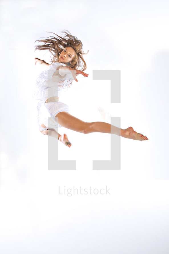 A dancer jumps on a white background
