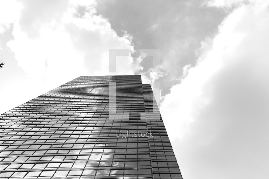A skyscraper looms large in the sky