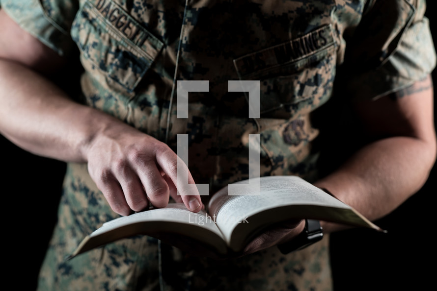 a marine reading a Bible