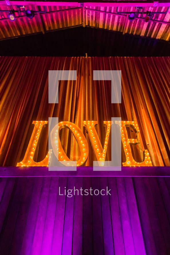 """Illuminated """"love"""" sign"""