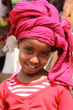 Young Ethiopian girl wearing a traditional head scarf