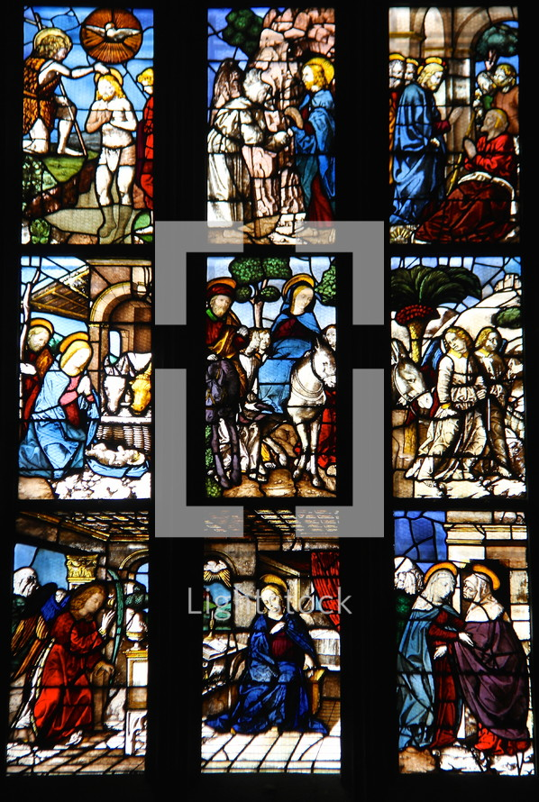 Stained glass windows in a church depicting stages of the life of Christ
