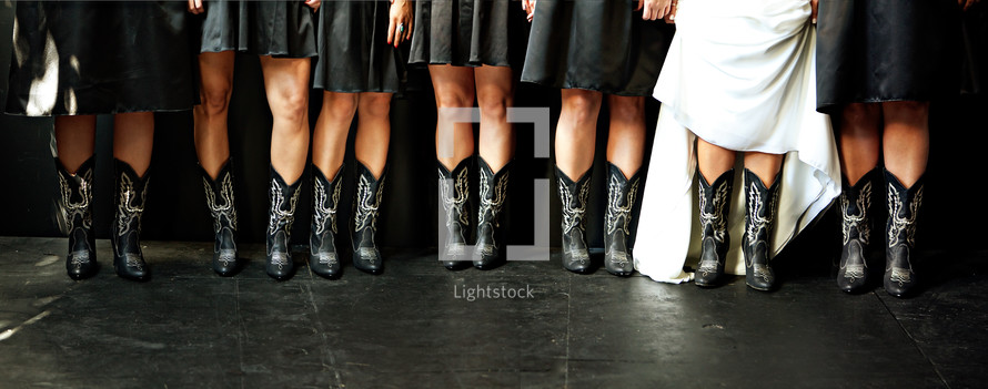 Bride and bridesmaids in cowboy boots