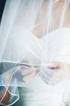 bride touching her veil