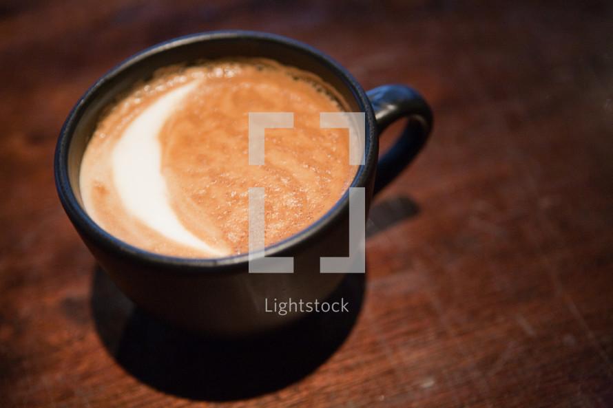 Foamy cup of coffee