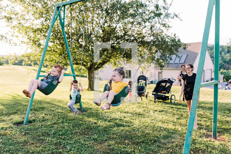 kids on a swing set