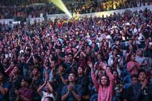 raised hands during worship music