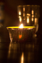 a candle in tin foil