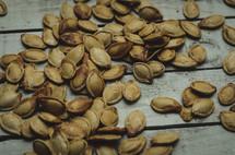 pumpkin seeds on wood